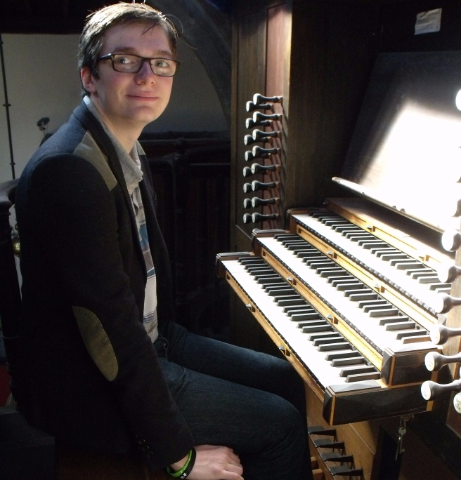 David at the organ console of St Oswald's Parish Church, Durham